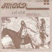 Coverafbeelding Amber ((1977)) - Just A Bit Attention